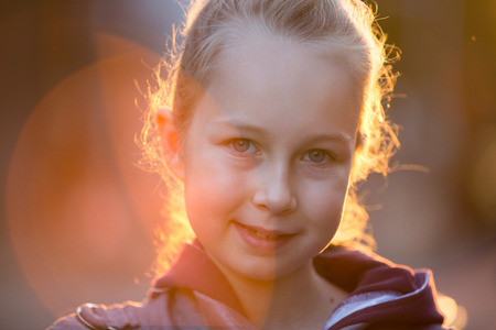 out door: Little girl out door portrait against of sunset lights