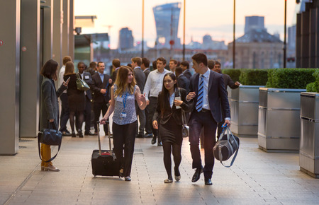 street corner: LONDON, UK - 7 SEPTEMBER, 2015: Canary Wharf business life. Business people going home after working day.