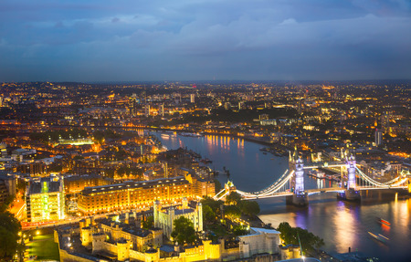 dealings: London at sunset. City background. Night lights with Tower bridge Stock Photo