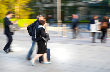 blurred people: LONDON, UK - MAY 21, 2015: Businessmen and businesswoman walking on the Bank street.