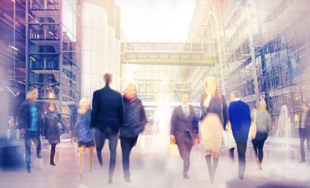 Walking people blur background Standard-Bild
