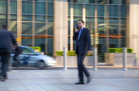 croud: LONDON, UK - MAY 21, 2015: Businessmen walking on the Bank street.