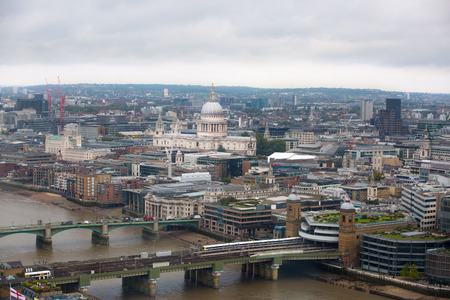 st pauls cathedral: London panorama. St. Pauls cathedral against of raining dark sky Stock Photo