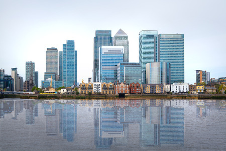 river banks: London, financial hub Canary Wharf view and river Thames Editorial