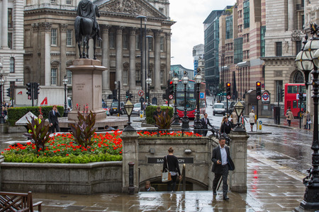 LONDON, UK - SEPTEMBER 17, 2015: Bank of England square after the rain and walking people