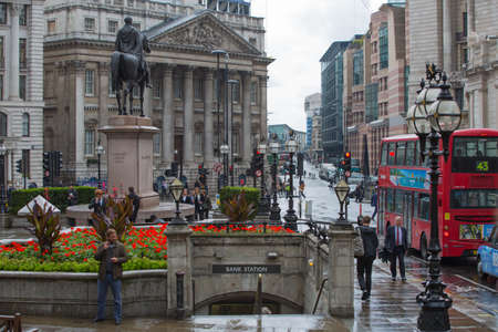 croud: LONDON, UK - SEPTEMBER 17, 2015: Bank of England square after the rain and people walking by Editorial