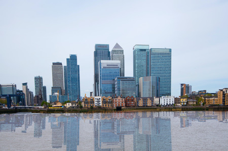 dealings: London, financial hub Canary Wharf view and river Thames Editorial