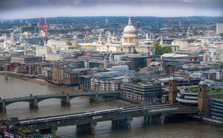 st   pauls cathedral: LONDON, UK - SEPTEMBER 17, 2015: London panorama with River Thames and London bridges and St. Pauls cathedral Editorial