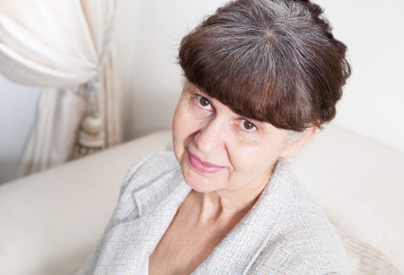 65 years old: 65 years old good looking woman portrait in domestic environment