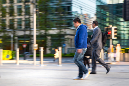 croud: LONDON, UK - MAY 21, 2015: Businessmen and businesswoman walking on the Bank street.