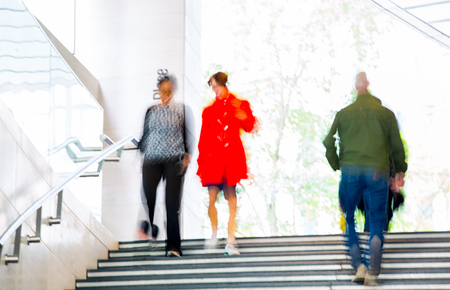 motion: People walking up to stairs, blur background. London