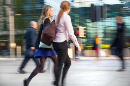 croud: LONDON, UK - MAY 21, 2015: Young woman walking on the Bank street.