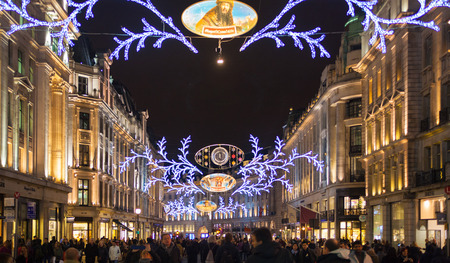 bargain hunting: LONDON, UK - NOVEMBER 30, 2014: Black Friday weekend in London the first sale before Christmas. Regent street beautifully decorated with Christmas lights. Editorial