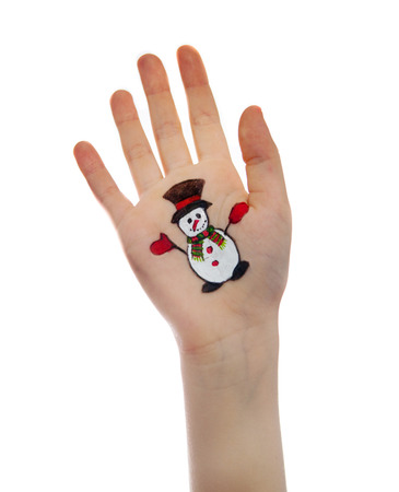 kids painted hands: Christmas symbols painted on kids hands.  Snowman