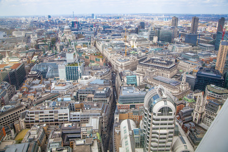 lloyds london: LONDON, UK - APRIL 22, 2015:  City of London aerial view, office buildings and streets. London panorama form 32 floor of Walkie-Talkie building Editorial