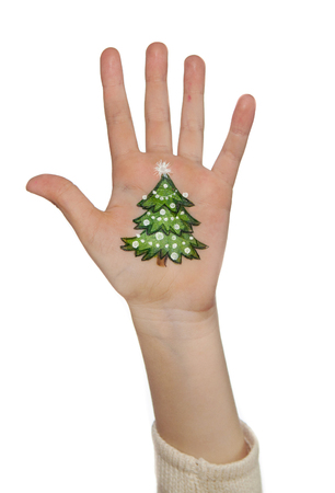 kids painted hands: Christmas symbols painted on kids hands.  Christmas tree,