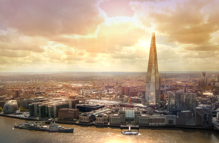 LONDON, UK - APRIL 22, 2015: City of London, Shard of Glass at sunset