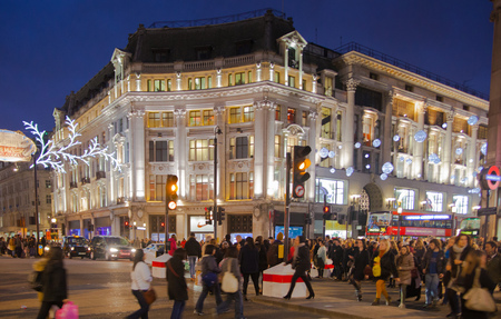 british touring car: LONDON, UK - AUGUST 22, 2015: Piccadilly Circus in night. Famous place for romantic dates. Square was built in 1819 to join of Regent Street Editorial