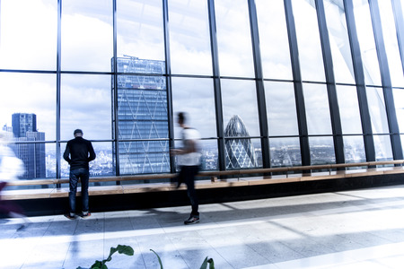 lloyd's of london: LONDON, UK - APRIL 22, 2015: Business people watching London skyline from the 32 floor of viewing hall