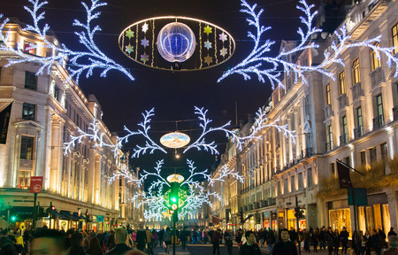 oxford street: LONDON, UK - NOVEMBER 30, 2014: Black Friday weekend in London the first sale before Christmas. Regent street beautifully decorated with Christmas lights. Editorial