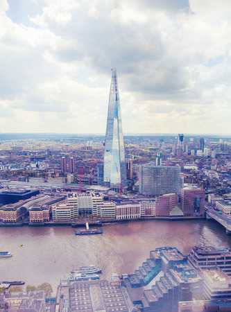 seance: LONDON, UK - APRIL 22, 2015:  City of London  in early morning atmosphere, Tower bridge and and River Thames. London panorama form 32 floor of Walkie-Talkie building