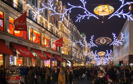 regent: LONDON, UK - NOVEMBER 30, 2014: Black Friday weekend in London the first sale before Christmas. Regent street beautifully decorated with Christmas lights. Editorial