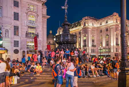 piccadilly: LONDON, UK - AUGUST 22, 2015: Piccadilly Circus in night. Famous place for romantic dates. Square was built in 1819 to join of Regent Street Editorial