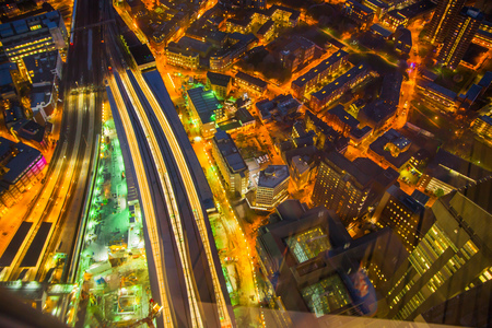 aerial view: LONDON, UK - APRIL 15, 2015: London night view. Aerial view at streets and buildings