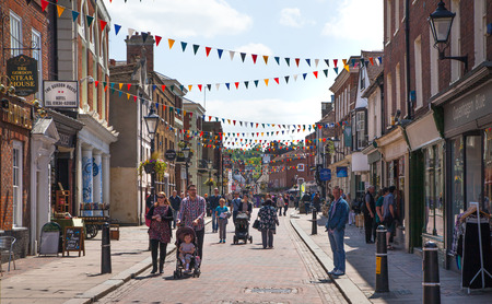 flower market: ROCHESTER, UK - MAY 16, 2015: Rochester high street at weekend. People walking through the street, passing cafes, restaurants and shops Editorial