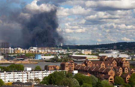 ware house: London, UK - May 18, 2015: Fire in East of London, ware house was burned