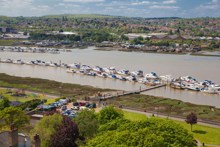 kent: ROCHESTER, UK - MAY 16, 2015: Landscape around of Rochester city include river Kent and yacht club with lots of speed boats and yachts