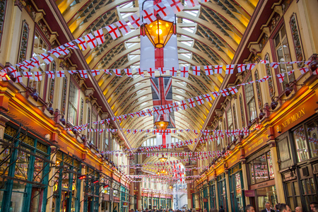 kingdom: LONDON, UK - APRIL 22, 2015: Cafe at Leadenhall market with lots of business people having a lunch. Editorial