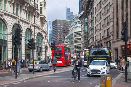 lloyd's of london: LONDON, UK - APRIL 22, 2015: City of London street view with buses and cars