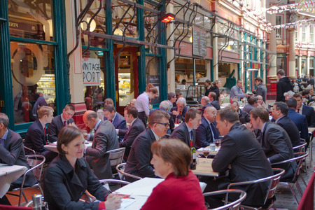 london people: LONDON, UK - APRIL 22, 2015: Cafe at Leadenhall market with lots of business people having a lunch. Editorial