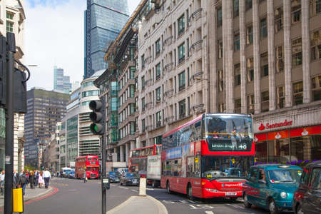 london skyline: LONDON, UK - APRIL 22, 2015: City of London street view with buses and cars