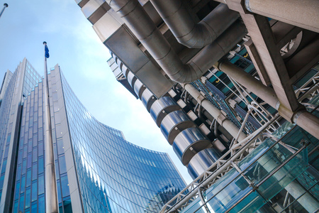 lloyds: LONDON, UK - APRIL 22, 2015: Lloyds of London building against of sky. Business background