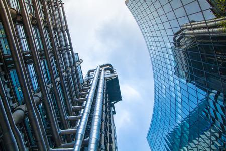 lloyd's: LONDON, UK - APRIL 22, 2015: Lloyds of London building against of sky. Business background