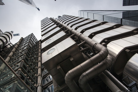 lloyd's of london: LONDON, UK - APRIL 22, 2015: Lloyds of London building against of sky. Business background