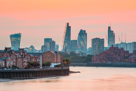 sunset city: City of London business and banking aria at sunset. Panoramic view