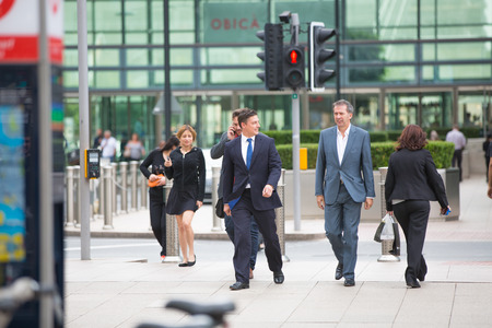 home life: LONDON, UK - SEPTEMBER 9, 2015: Office workers going home after working day in Canary Wharf. Business life of London