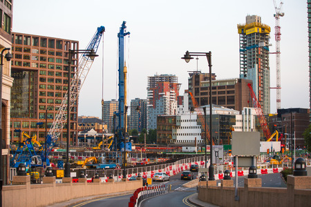 uk: LONDON, UK - SEPTEMBER 9, 2015: Building construction site with cranes and industrial units  in Canary Wharf aria