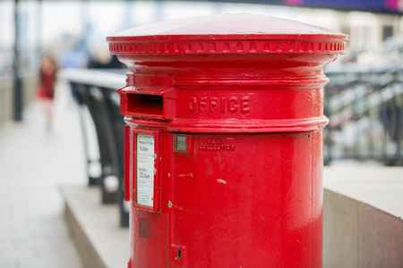 royal mail: LONDON, UK - SEPTEMBER 9, 2015: Her Majesty Royal mail Red post box Stock Photo