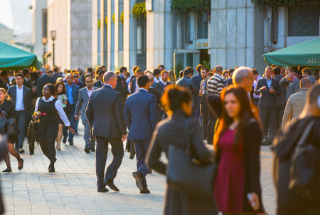 going: LONDON, UK - SEPTEMBER 9, 2015: Office workers going home after working day in Canary Wharf. Business life of London