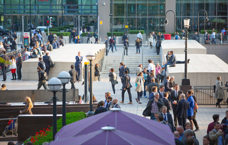 canary wharf: LONDON, UK - SEPTEMBER 9, 2015: Office workers going home after working day in Canary Wharf. Business life of London