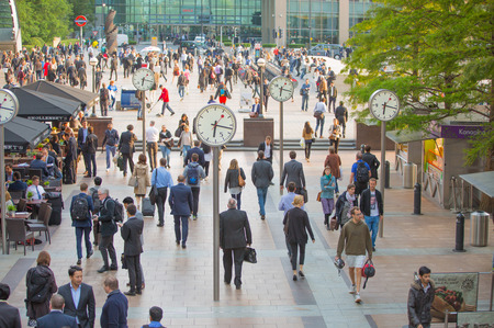 LONDON, UK - SEPTEMBER 9, 2015: Office workers going home after working day in Canary Wharf. Business life of London