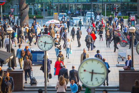 crowds of people: LONDON, UK - SEPTEMBER 9, 2015: Office workers going home after working day in Canary Wharf. Business life of London