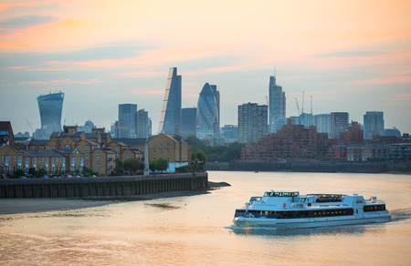 sunset city: Sunset in London, City of London office and banking aria and River Thames Editorial