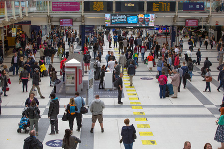 uk: LONDON, UK - SEPTEMBER 12, 2015: Liverpool street train station with lots of people, waiting boarding, looking for information and passing hall