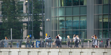canary wharf: LONDON, UK - SEPTEMBER 14, 2015:  Office workers going to work. Early morning hours in Canary Wharf business life Editorial