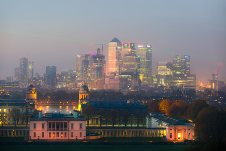 the meridian: London, UK - October 31, 2015:  Panorama of Canary Wharf in night. View includes the park, Royal chapel, Painted hall and green light of Greenwich zero tome meridian